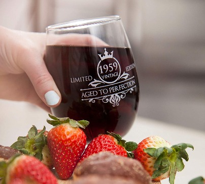 "Imprinted ergonomic wine glass with text ""VINTAGE 1959 AGED TO PERFECTION"". Excellent gift for 60 year old birthday party."