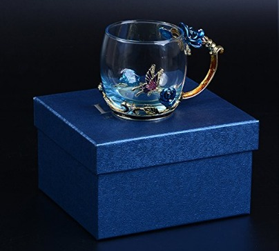 Beautiful glass cup decorated by flower and butterfly. The perfect gift for family, friends or that special someone. Spoon and coaster included in set.