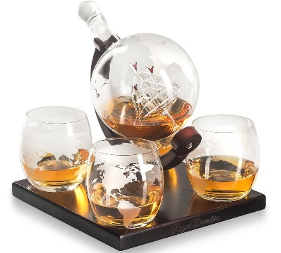 The unique 850ml decanter with skillfully hand-blown ship inside on elegant wooden base. The set include four bar glasses with beautiful wooden base.