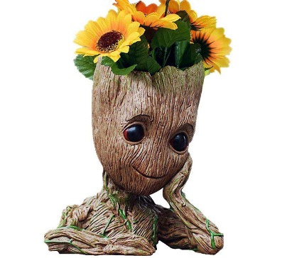Multifunctional Groot-shaped flower pot from the Guardians of The Galaxy. It can be used as an ornament, a pen holder or even a flower pot for small plants.