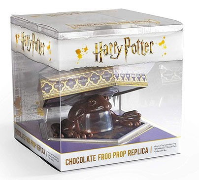 A replica of edible chocolate frog from the Honeydukes confectionery. It contains a detailed box of souvenirs and the famous card of Dumbledore's wizard.