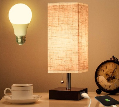 Stylish table lamp with a wooden base. USB port located in the base allows you to charge your mobile phone. E26 US universal standard bulb.