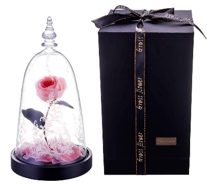 A beautiful handmade rose made of clay, on a wooden base, inside a glass dome. 100% real rose. Available in different colors.