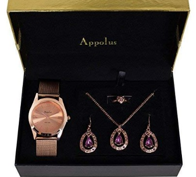 A beautiful necklace, earrings, watch and ring set in a pink-gold color. This elegant and stylish set is perfect for work, date or social events.