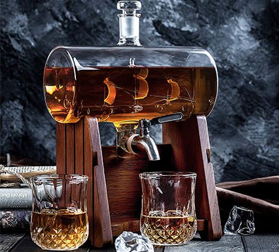 Huge 1150 ml whiskey decanter with a glass ship at the center on oak wood stand and two 220ml glasses set. Set comes packaged in a magnetic closure gift box.